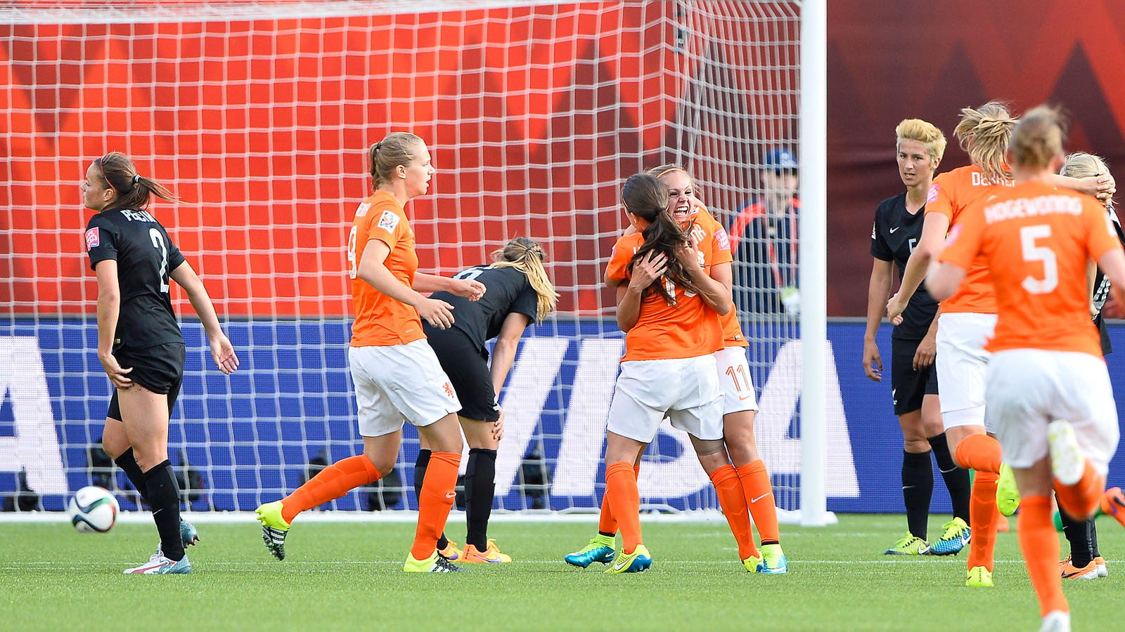 Lieke Martens is mobbed by her teammates after lacing a 20-yard rocket for the Netherlands' first Women's World Cup goal in the nation's debut match in the competition.
