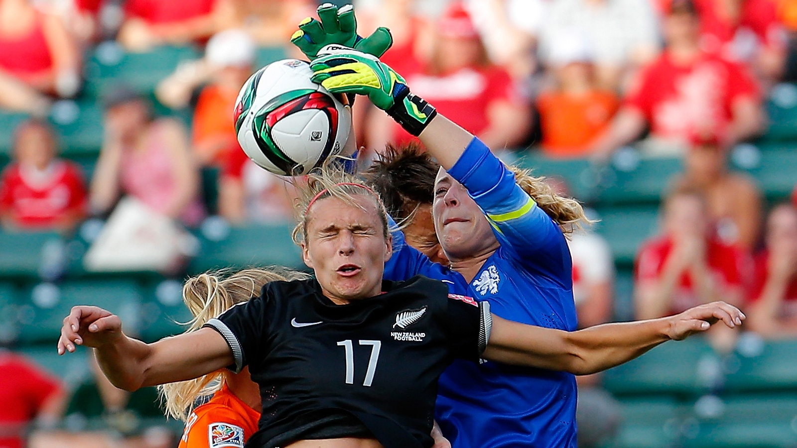 Netherlands goalkeeper Loes Geurts defends a corner kick against New Zealand's Hannah Wilkinson and Sarah Gregorius.
