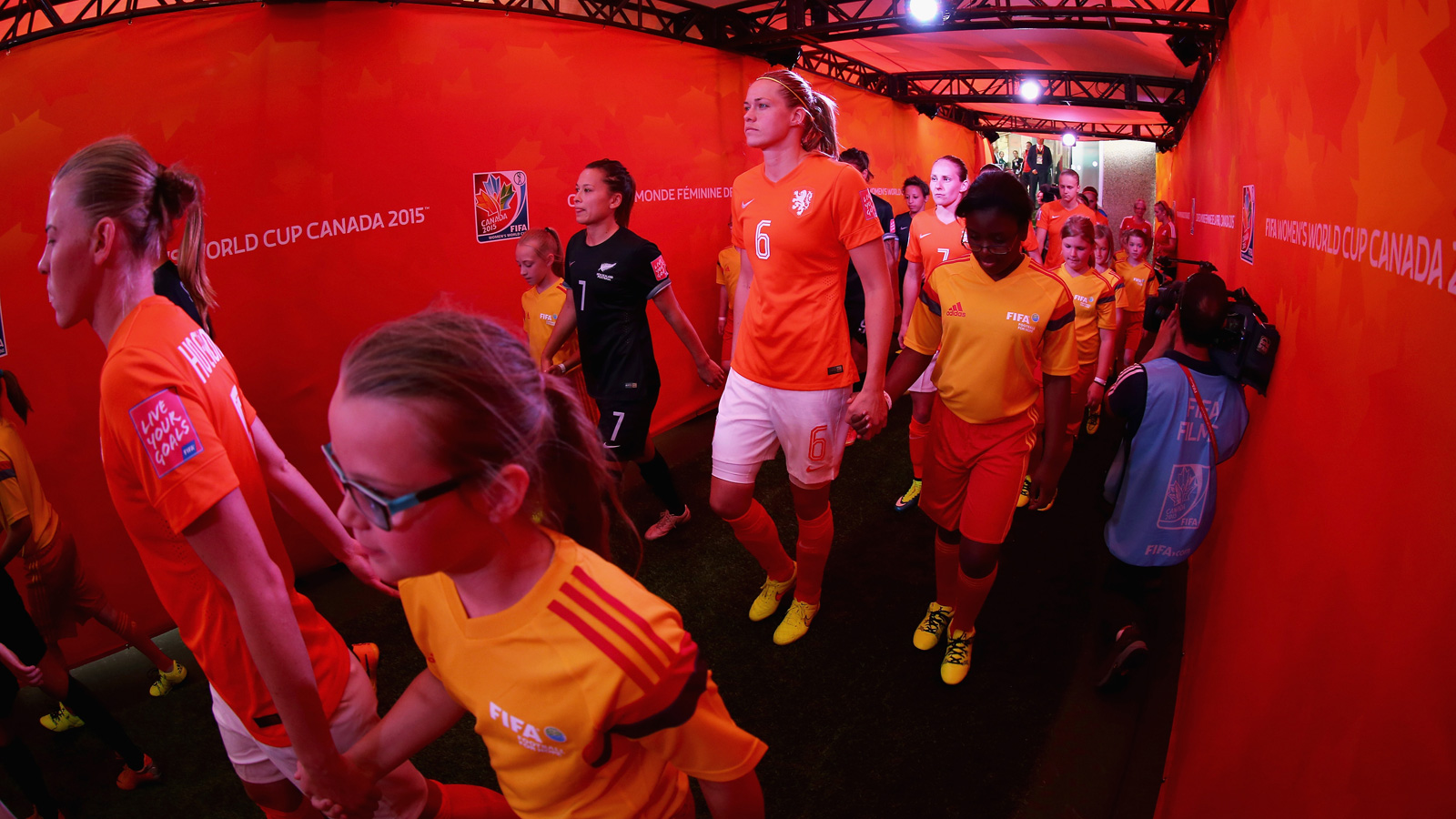 Netherlands and New Zealand players walk through the tunnel out to the Commonwealth Stadium field for their Group A encounter in the Women's World Cup.