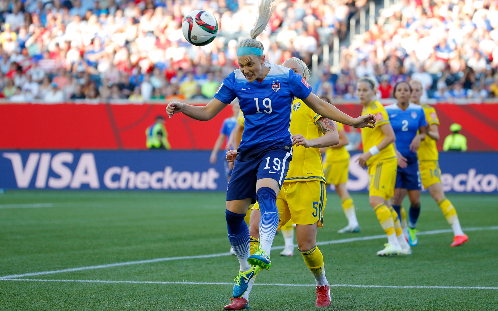 Julie Johnston wins the header in a dominant showing on the U.S. back line, helping the Americans preserve a 0-0 draw against Sweden in the second game of the Women's World Cup group stage.