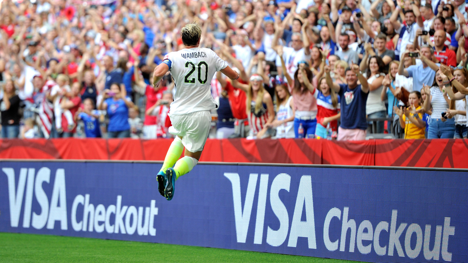 Abby Wambach leaps for joy after scoring in the 45th minute off Megan Rapinoe's corner kick, which delivered a 1-0 win to the USA and first place in Group D of the Women's World Cup.
