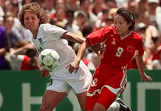 Michelle Akers, left, battles China's Yan Jin in the 1999 FIFA Women's World Cup final