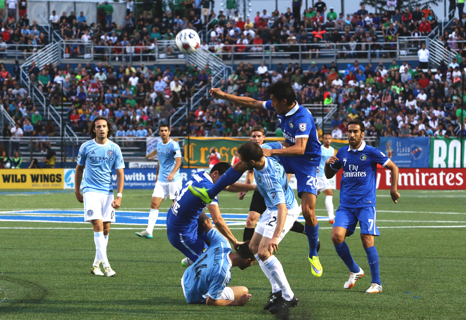 New York Cosmos defender Hunter Gorskie (3) and midfielder Hunter Restrepo (20) get into a physical midfield battle with NYCFC midfielder Pablo Alvarez (22) and forward Patrick Mullins (14).