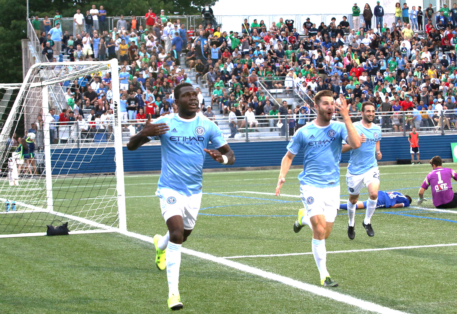 NYCFC midfielder Kwadwo Poku (88) and forward Patrick Mullins (14) run toward the away supporters section to celebrate Poku's goal in front of their fans.