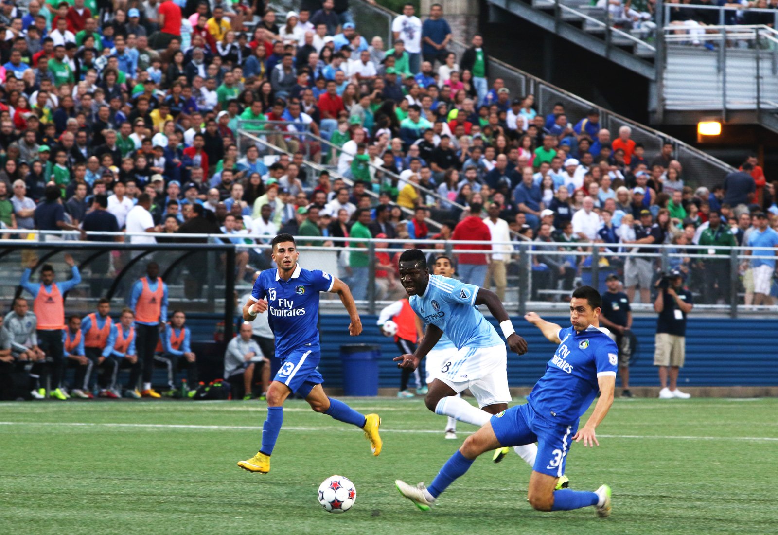 New York Cosmos defender Hunter Gorskie (3) and midfielder Sebastian Ignacio Guenzatti Varela (13) chase after NYCFC midfielder Kwadwo Poku (88) as he runs toward goal.