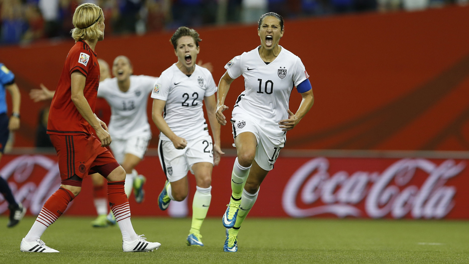 Carli Lloyd yells in celebration after scoring the penalty that put the USA up over Germany en route to a 2-0 victory in the Women's World Cup semifinals.
