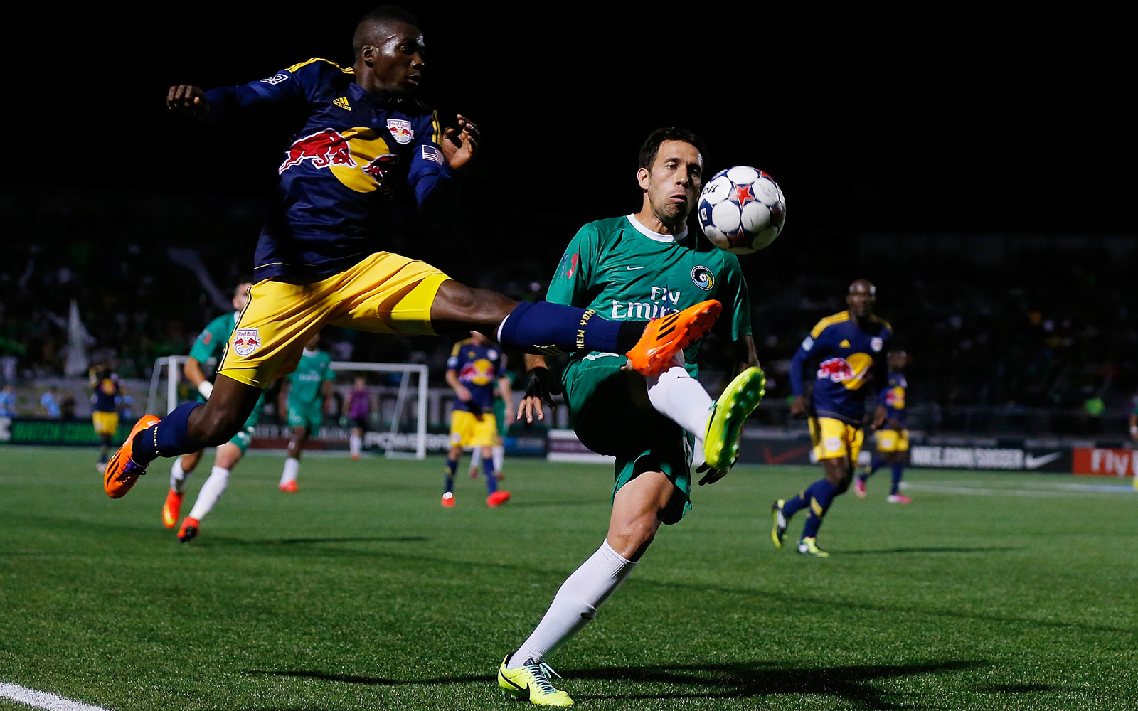 Ambroise Oyongo goes airborn in the New York Red Bulls' 2014 U.S. Open Cup match against the New York Cosmos.