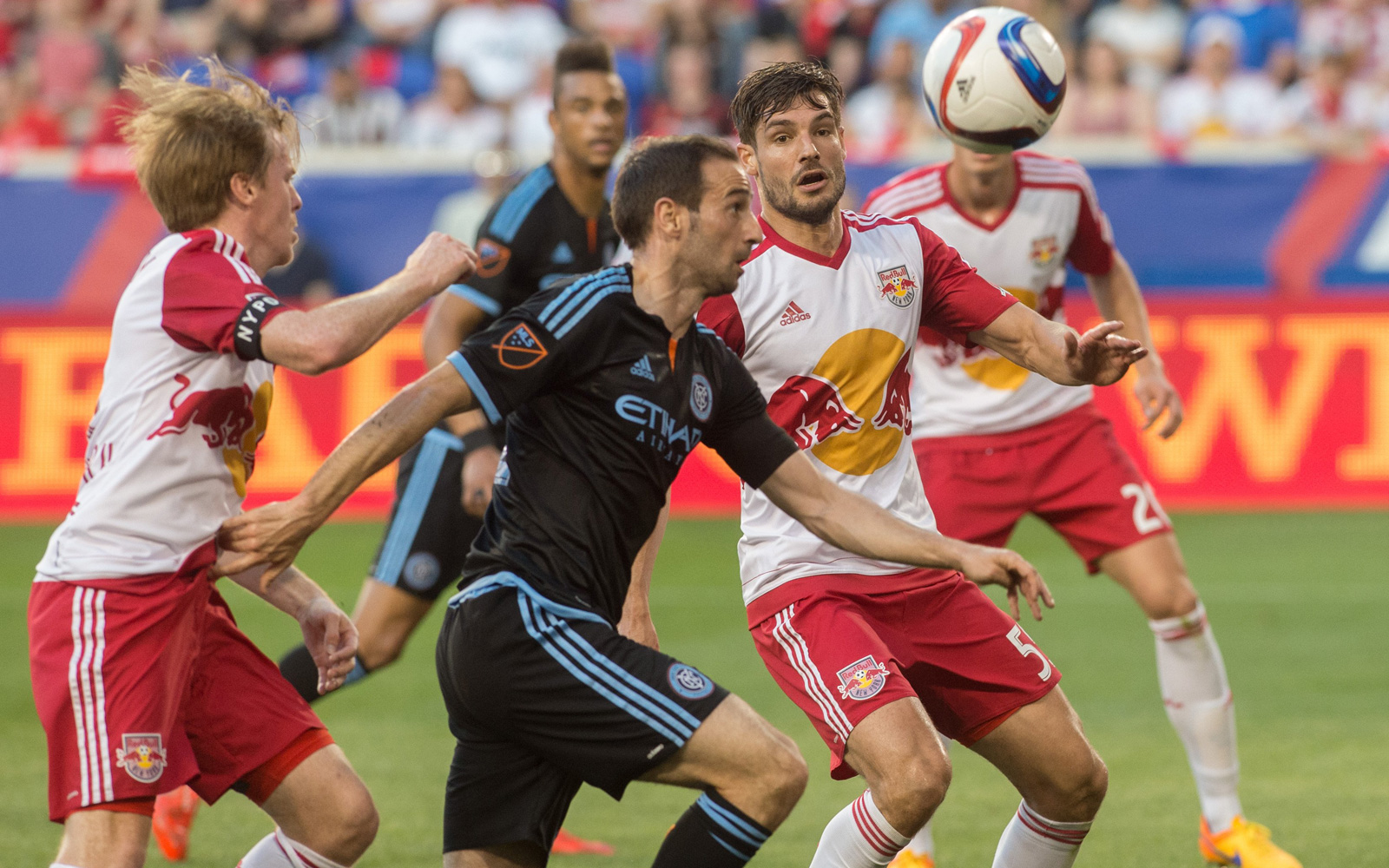 NYCFC's Pablo Alvarez tries to get by a throng of Red Bulls defenders in a 2-1 loss for the MLS expansion club at Red Bull Arena on May 10, 2015.
