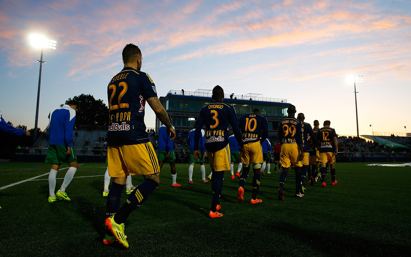 The New York Red Bulls and New York Cosmos walk out to line up ahead of their 2014 U.S. Open Cup clash at Hofstra University's Shuart Stadium.