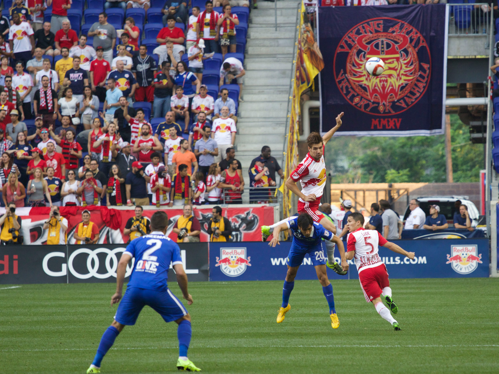 New York Red Bulls defender Damien Perrinelle (55) and New York Cosmos midfielder Walter Restrepo (20) collide while vying for the ball in the first half of the 2015 U.S. Open Cup fifth-round match at Red Bull Arena.