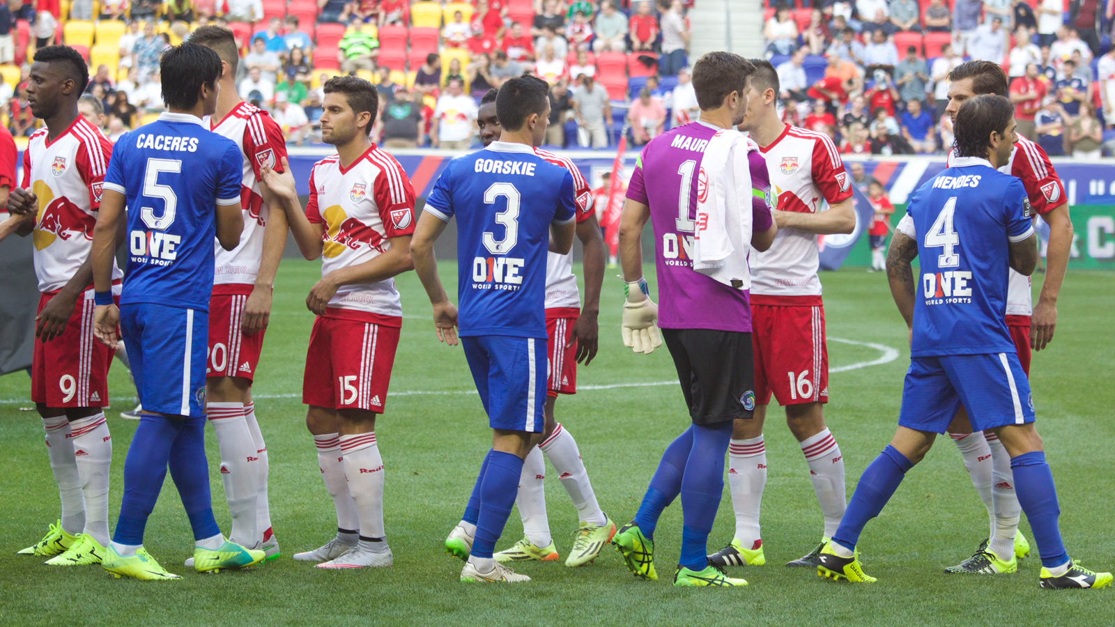 The New York Cosmos (Blue) and the New York Red Bulls (White) shake hands before the beginning of their U.S. Open Cup fifth-round match at Red Bull Arena in Harrison, New Jersey.