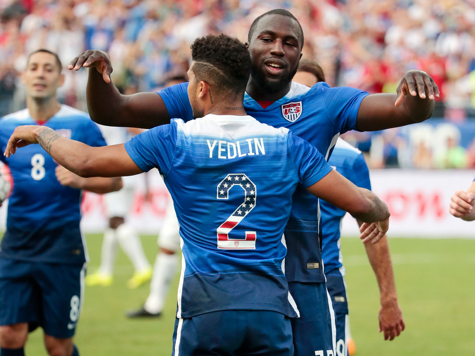 DeAndre Yedlin and Jozy Altidore, wearing special jerseys with stars-and-stripes numbers for July 4, celebrate after a Guatemala own goal gifts the USA a 1-0 lead during a 4-0 win in Nashville, Tennessee, prior to the CONCACAF Gold Cup.