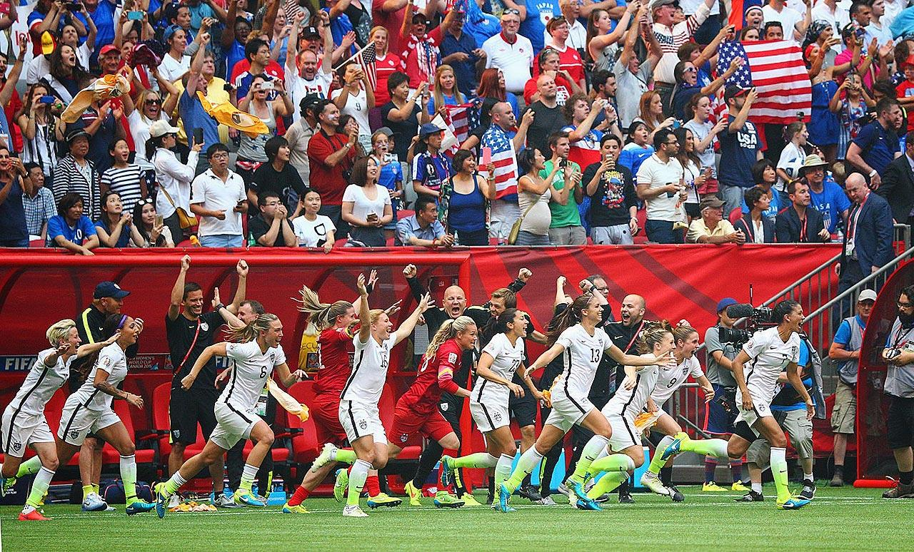 U.S. players rush the field after the final whistle, which sealed their 5-2 triumph over Japan and a record third World Cup title.