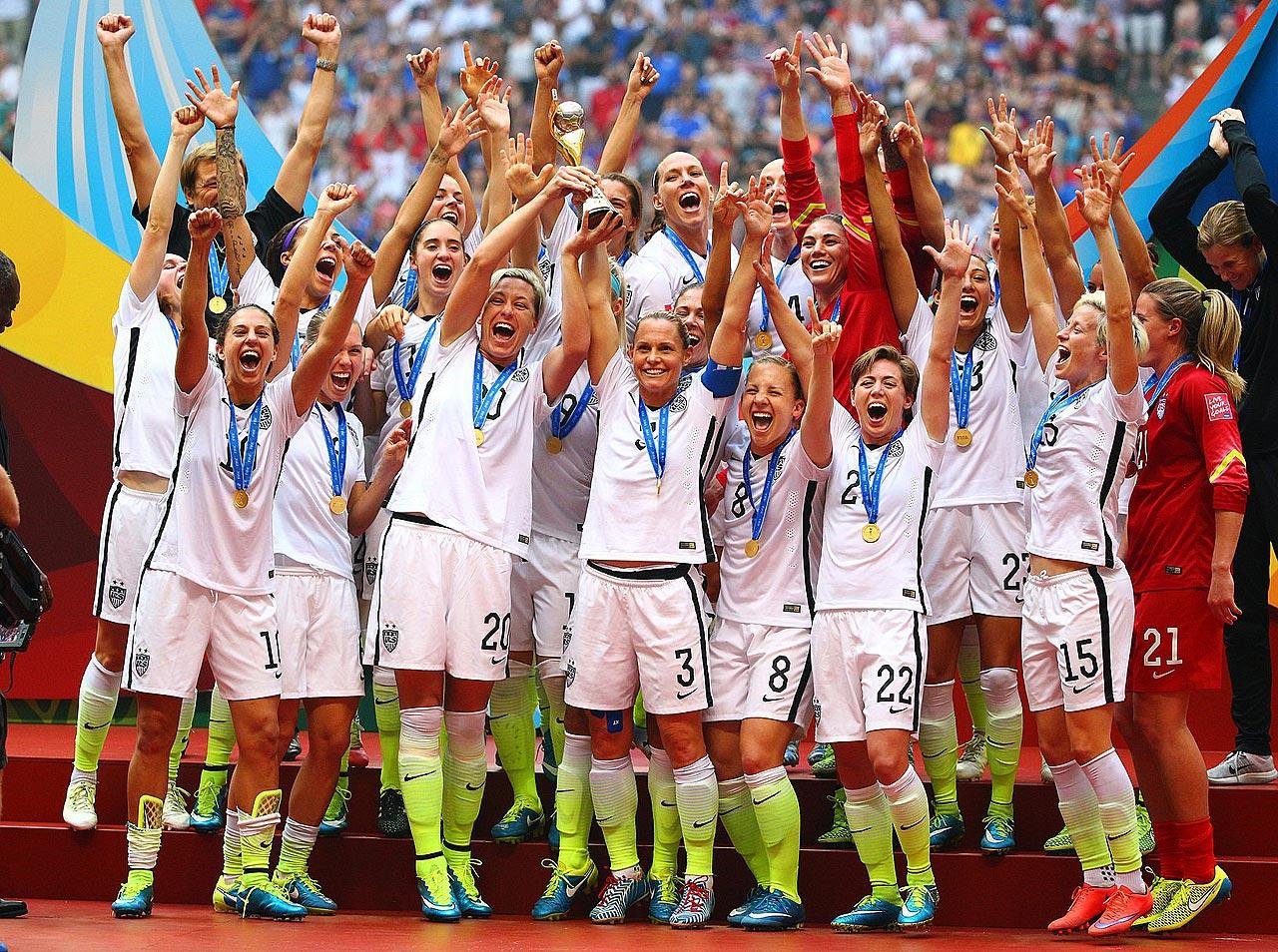 Victorious, the U.S. women's national team raises the World Cup trophy for the third time, but the first in 16 years, after completing a 5-2 win over Japan in the final at Vancouver's BC Place.