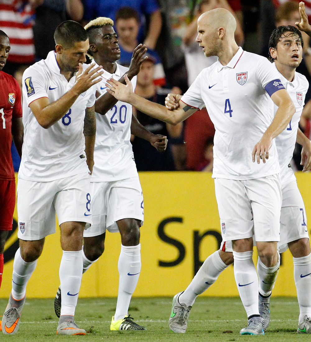Clint Dempsey, left, and Michael Bradley, right, celebrate after the latter's goal in the USA's 1-1 draw vs. Panama, which wrapped up group play in the CONCACAF Gold Cup.