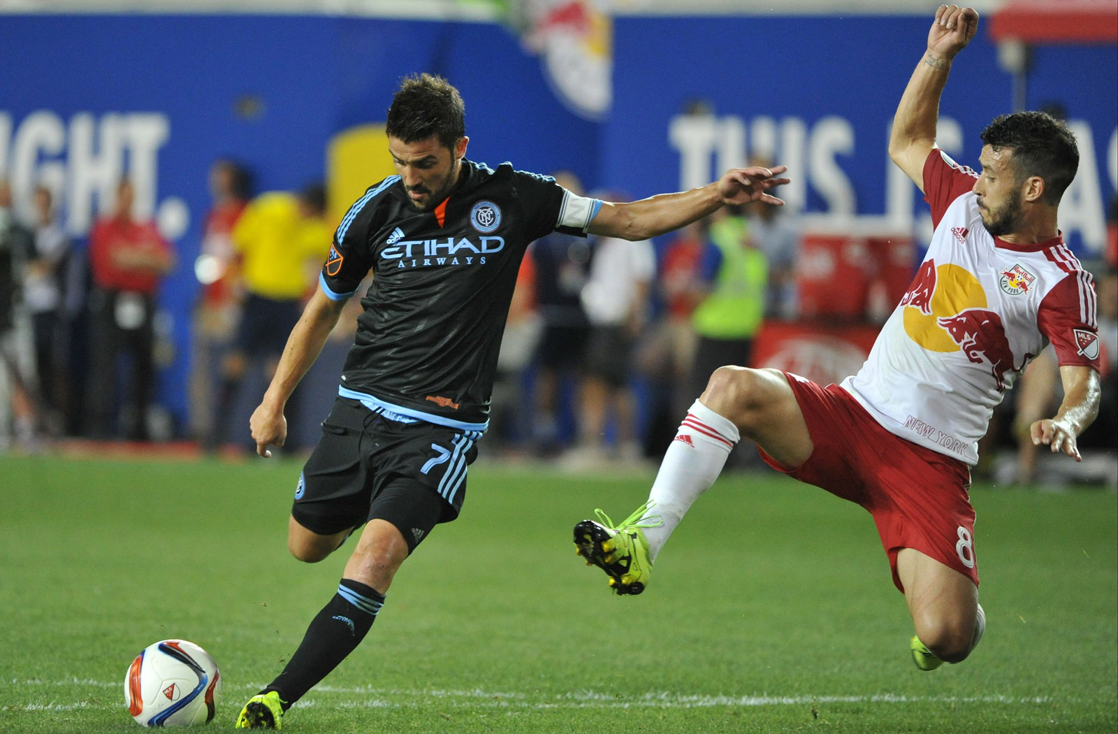 Red Bulls midfielder Felipe leaves his feet trying to stop NYCFC's David Villa. The former iced the 2-0 win at Red Bull Arena with a goal.