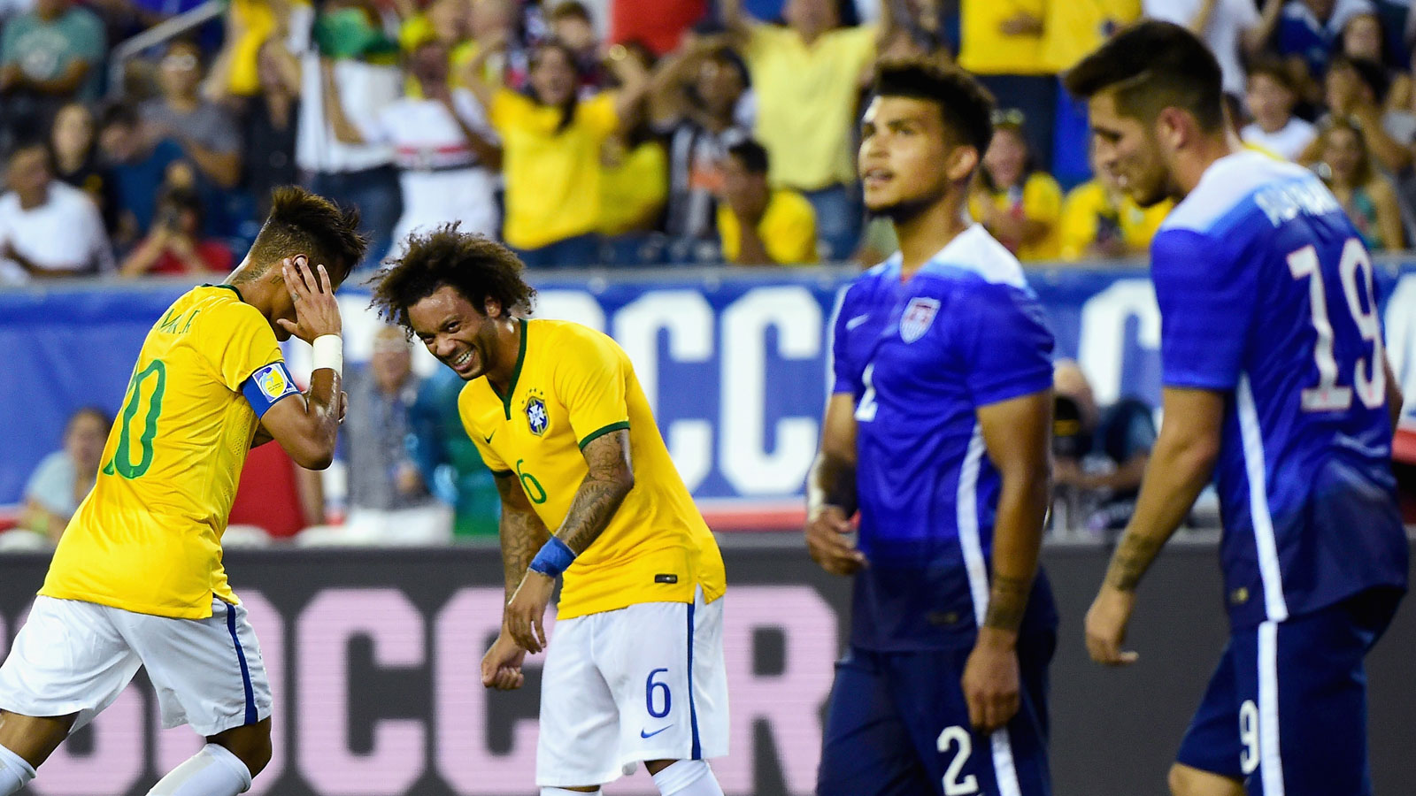 Neymar and Marcelo celebrate while DeAndre Yedlin and Ventura Alvarado look away in disgust during Brazil's 4-1 rout of the USA at Gillette Stadium.