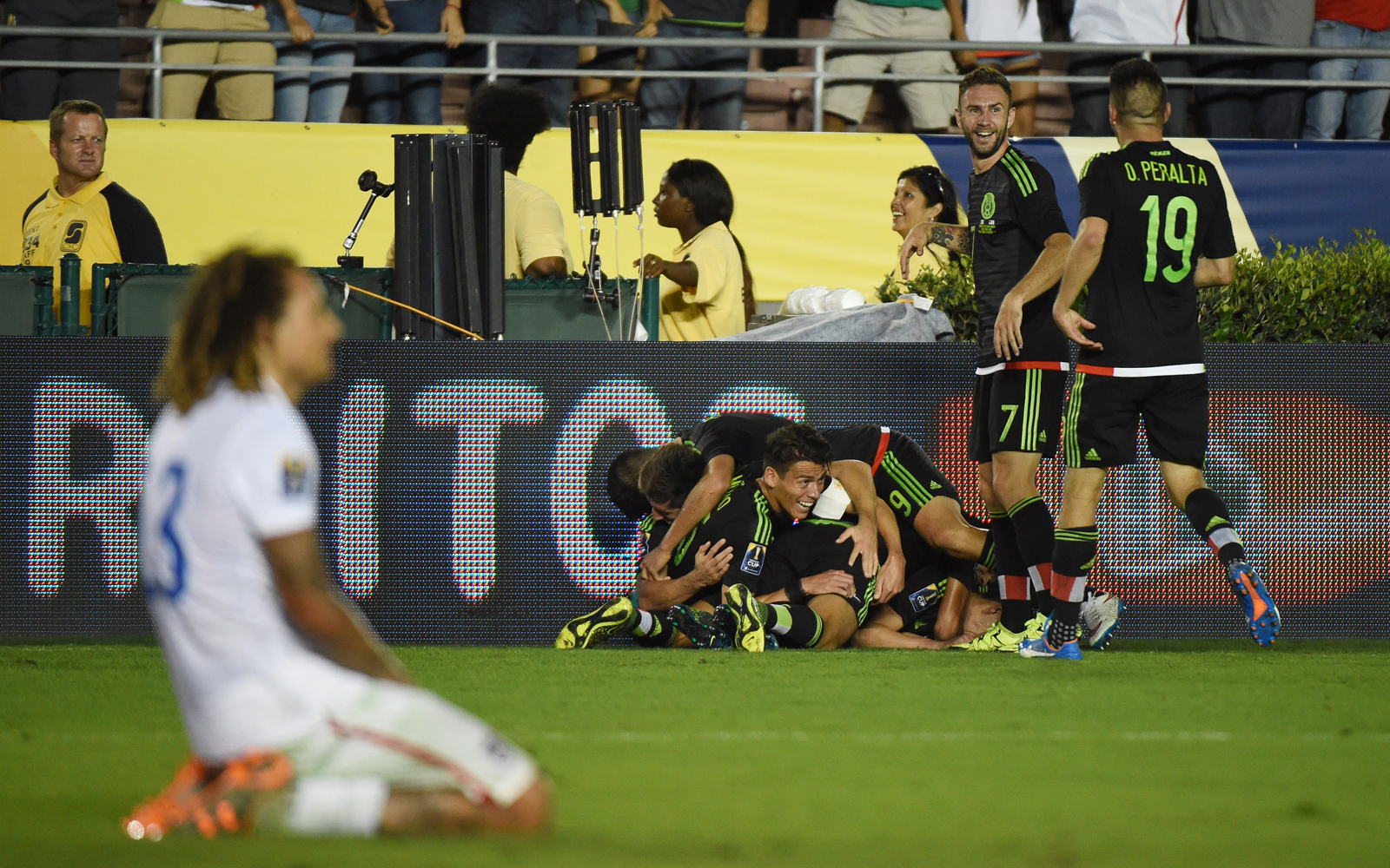 Jermaine Jones falls to his knees in disappointment as Mexico celebrates after Paul Aguilar's sensational volley in extra time captured the CONCACAF Cup for El Tri and sends the U.S. rival to the 2017 FIFA Confederations Cup.