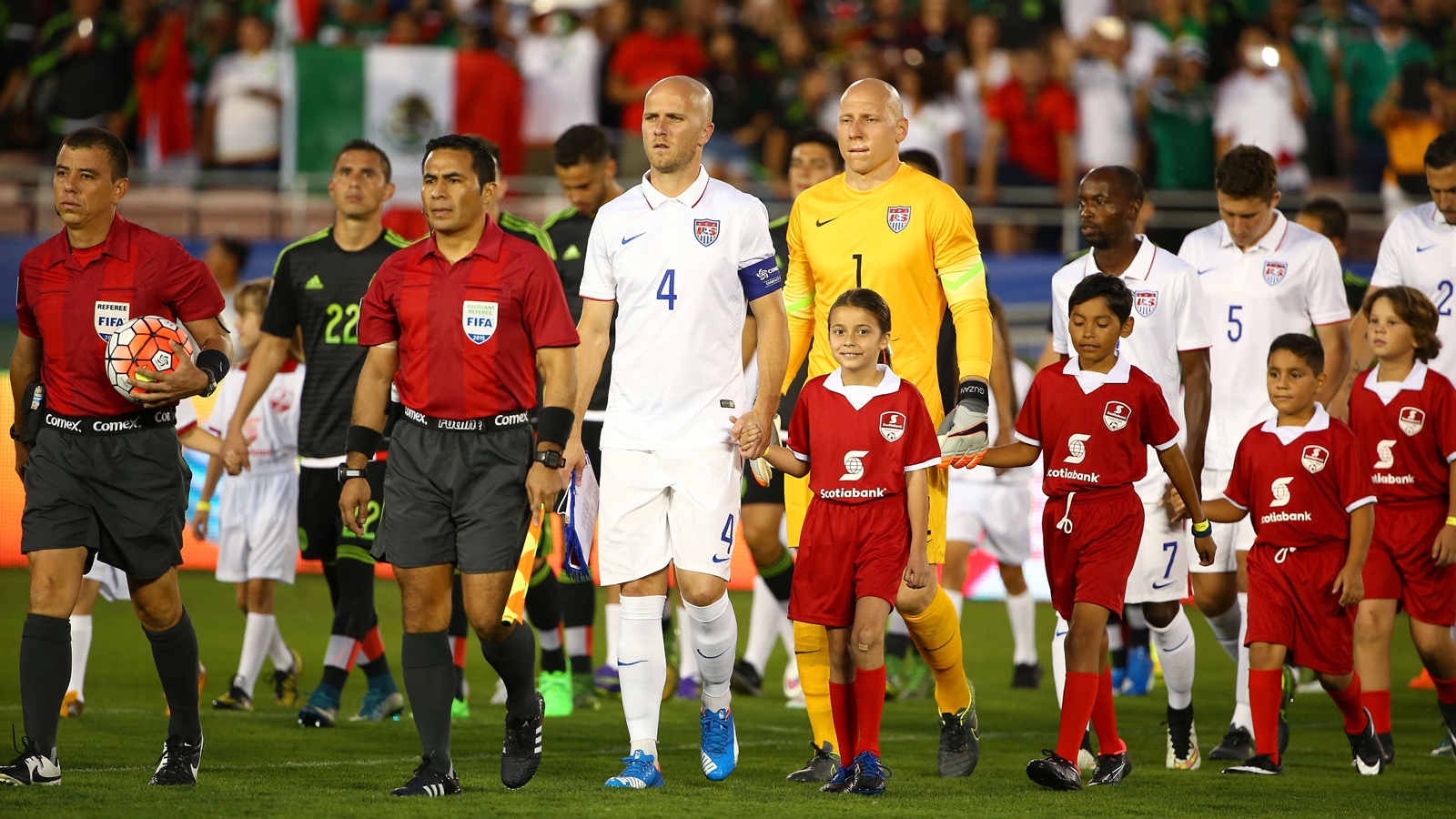 Captain Michael Bradley leads the USA out onto the field ahead of the Americans' CONCACAF Cup playoff vs. Mexico at the Rose Bowl.