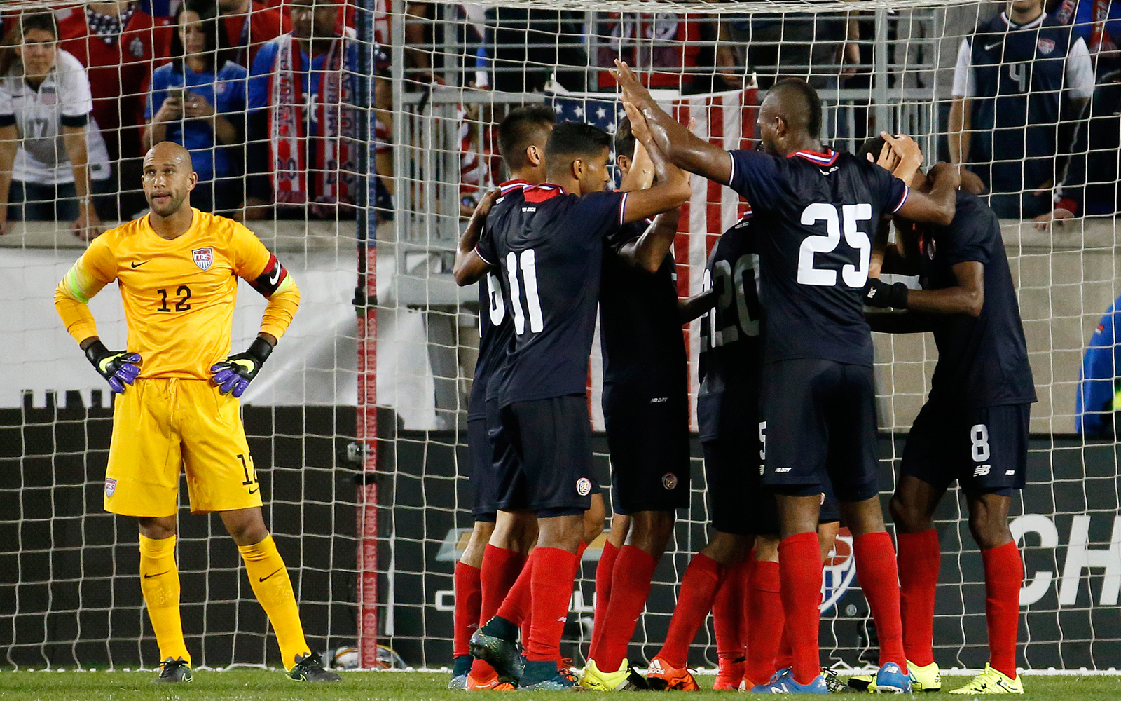 Tim Howard can't watch as Costa Rica players celebrate Joel Campbell's goal in a 1-0 friendly win at Red Bull Arena. The match marked Howard's return to the U.S. goal for the first time since the 2014 World Cup round of 16.