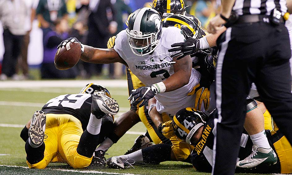 Michigan State 16, Iowa 13: A hard-nosed touchdown run by L.J. Scott with 27 seconds remaining lifted the Spartans past the Hawkeyes in the Big Ten championship game. The win also secured Michigan State's place in the College Football Playoff.