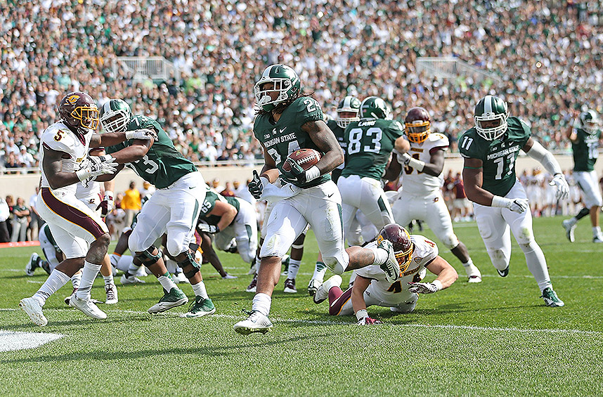 Michigan State 30, Central Michigan 10: Gerald Holmes rushed for two touchdowns to lead the Spartans over the Chippewas, while defensive lineman Shilique Calhoun had a big day on defense and special teams.