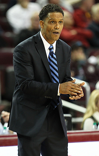 After starting in the Final Four for Dean Smith at Carolina, King Rice went into coaching.