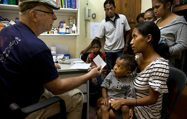 In his medical work, Murphy has almost exclusively sought out underserved people. Here he is in 2012 seeing patients in East Timor.