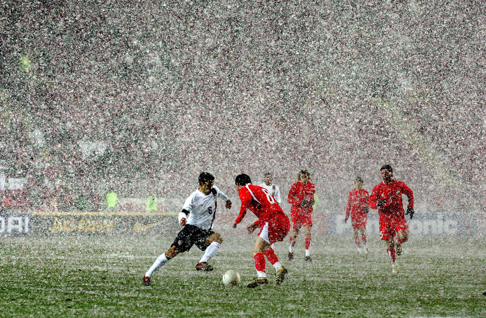 USA's Steve Cherundolo tries to navigate a snowy pitch and the Poland defense in a friendly in Germany in 2006.