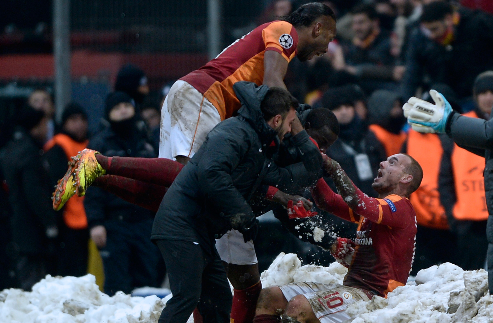 Galatasaray's Didier Drogba and Wesley Sneijder celebrate in the Champions League clash vs. Juventus in the snow in Istanbul in December 2013.
