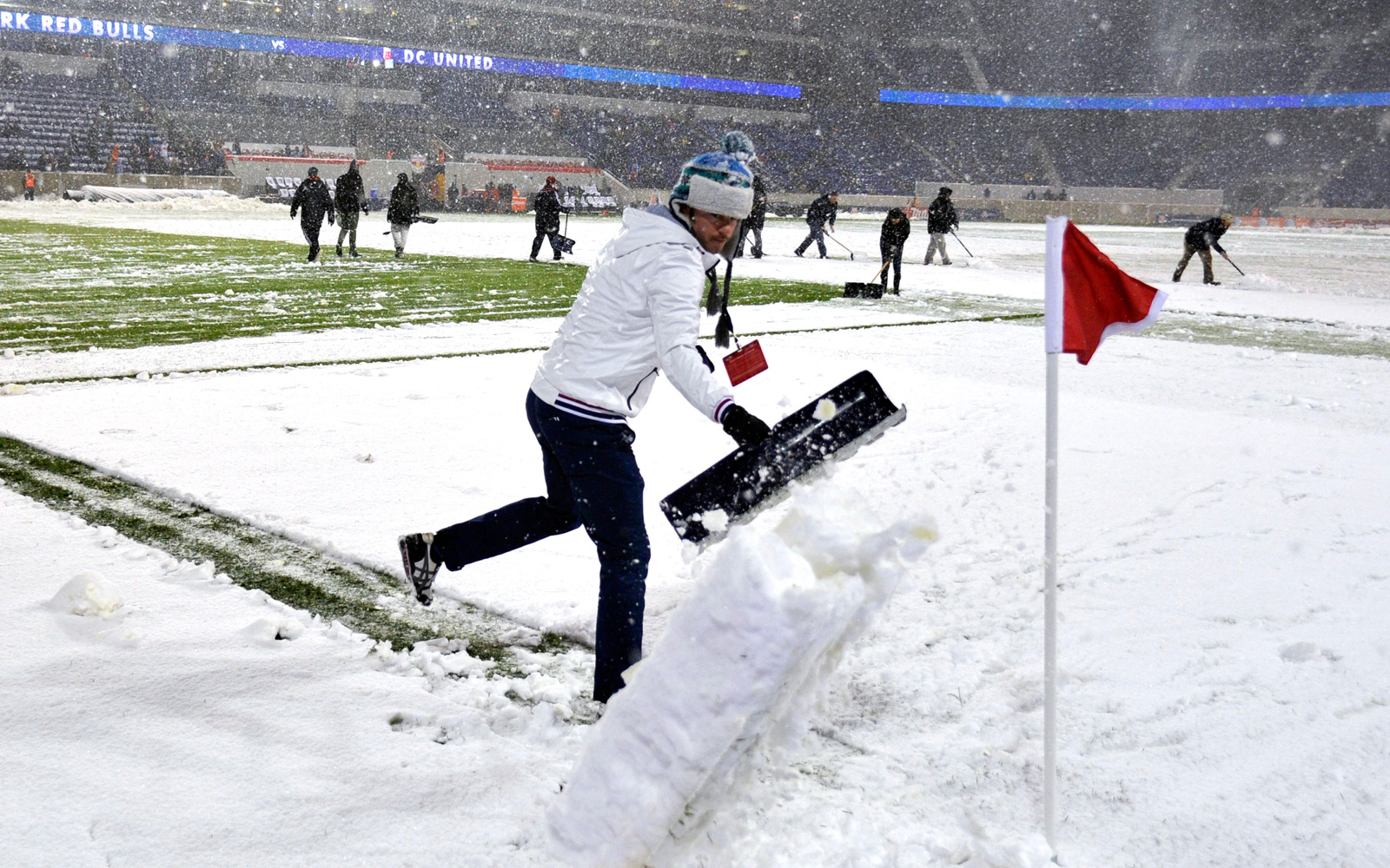 Groundsmen attempt to clear the Red Bull Arena field, but they couldn't do enough to keep the 2012 Eastern Conference semifinal clash between D.C. United and the New York Red Bulls from being postponed.