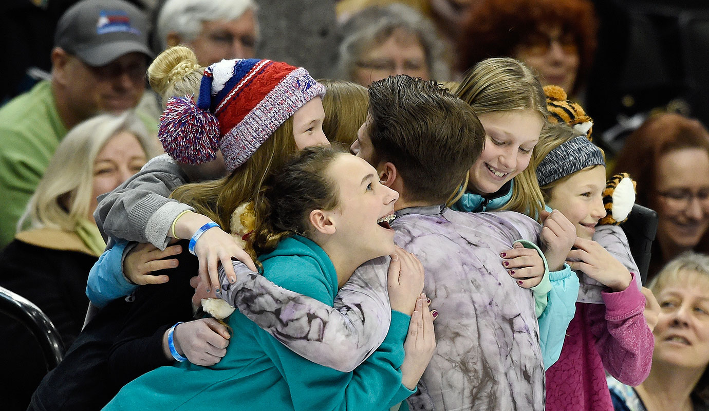 Alexander Johnson hugs fans after he competes in the Free Skate at the 2016 Prudential U.S. Figure Skating Championship at Xcel Energy Center in St Paul, Minn.