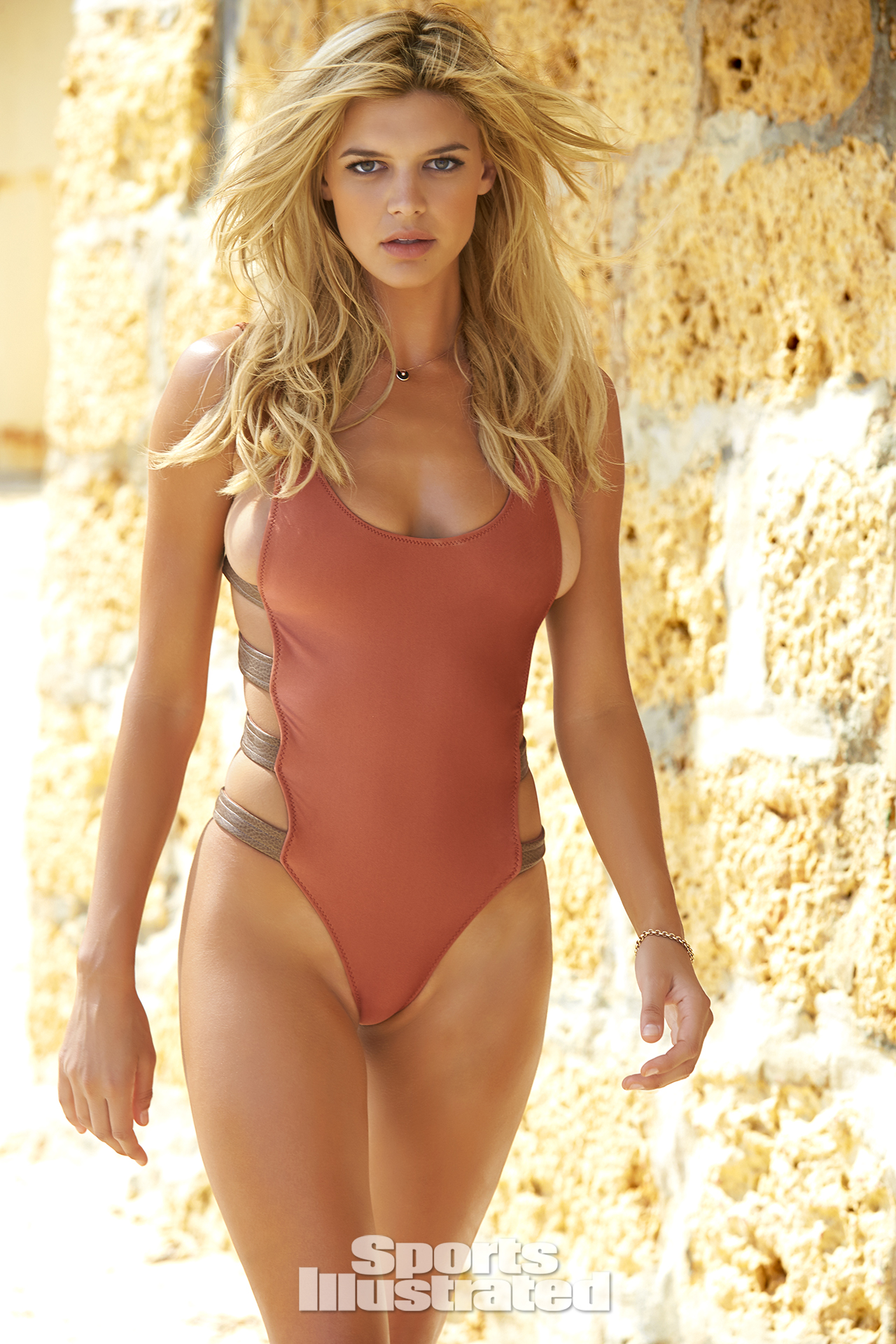 Kelly Rohrbach was photographed by Ben Watts in Malta. Swimsuit by RED VELVET By Nicole Marcella.
