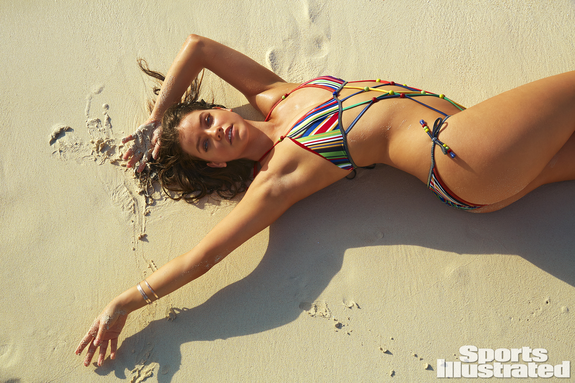 Barbara Palvin was photographed by James Macari in Turks & Caicos. Swimsuit by Hilfiger Collection.