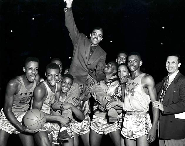 Crispus Attucks celebrates a victory after its regional title in 1954.