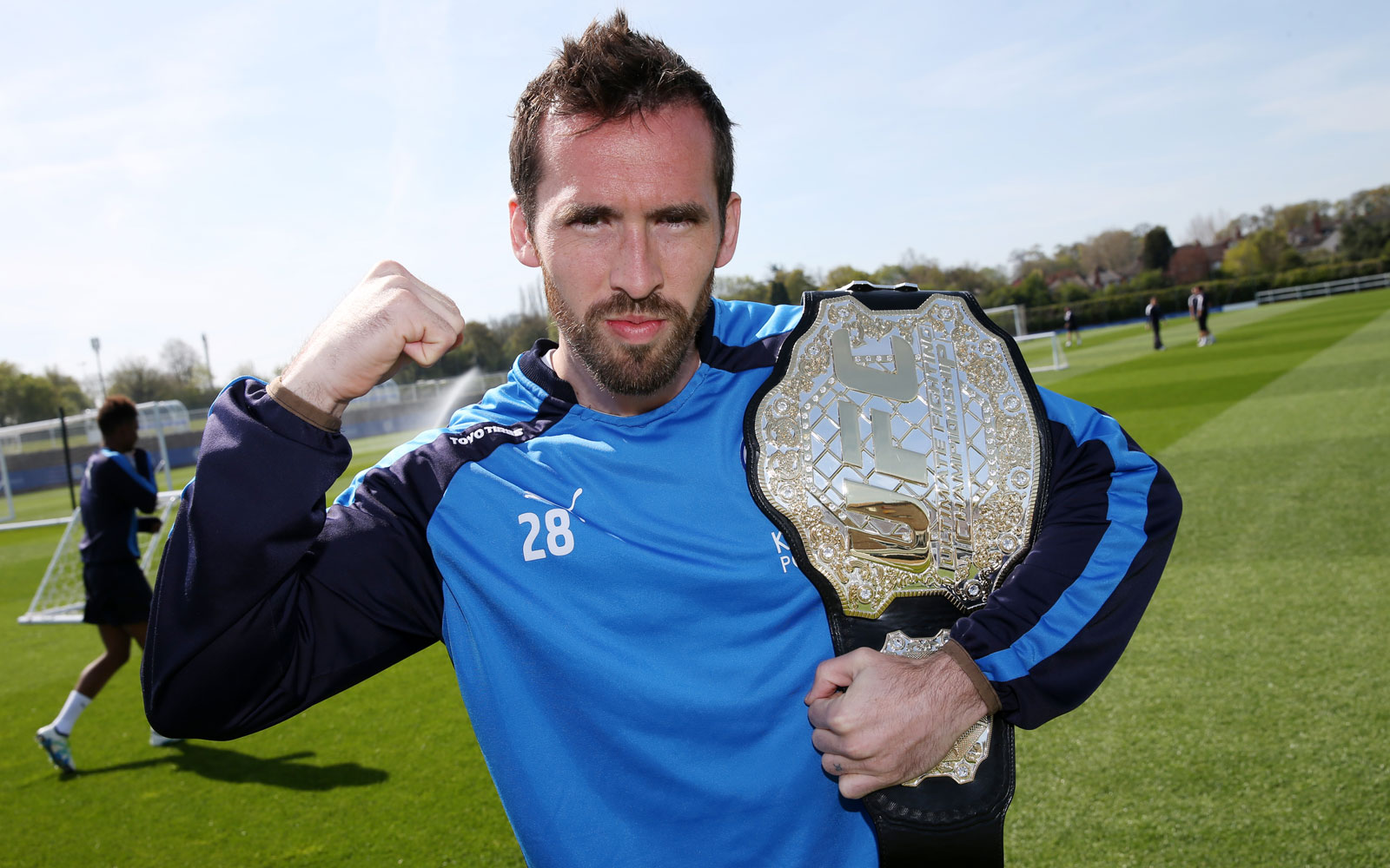 Leicester's Christian Fuchs poses with the UFC title belt as part of Leicester's title celebrations.