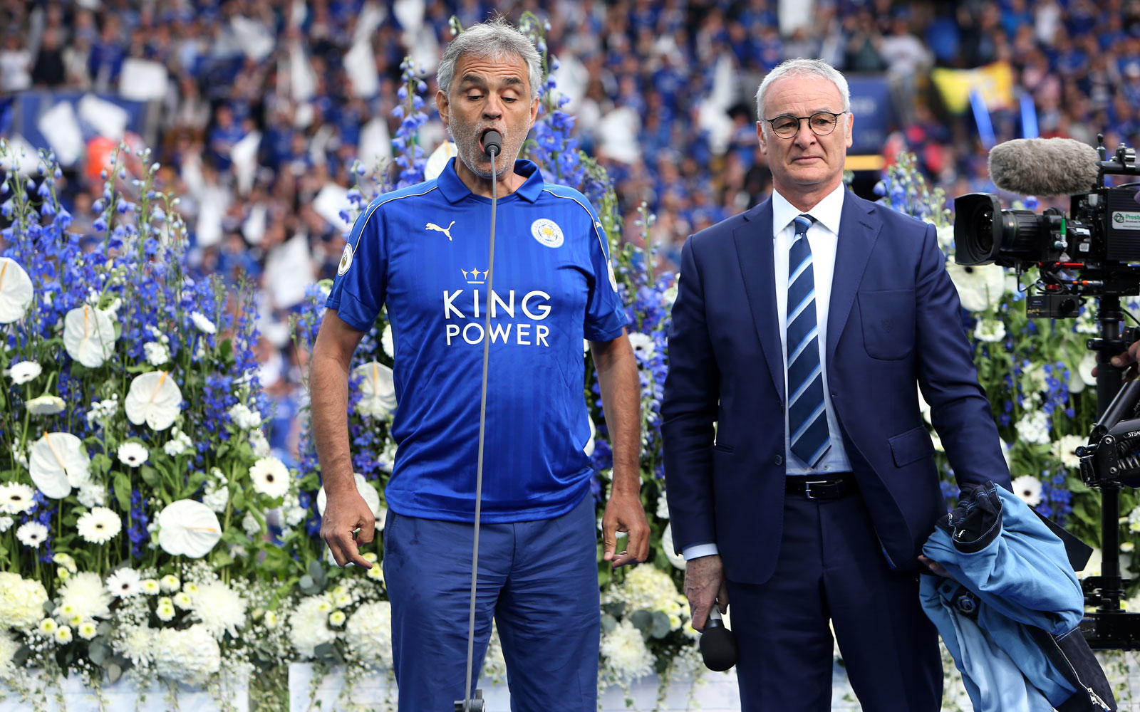 Famed tenor Andrea Bocelli appears on stage with Claudio Ranieri to sing ahead of Leicester's match vs. Everton as part of the title celebrations.