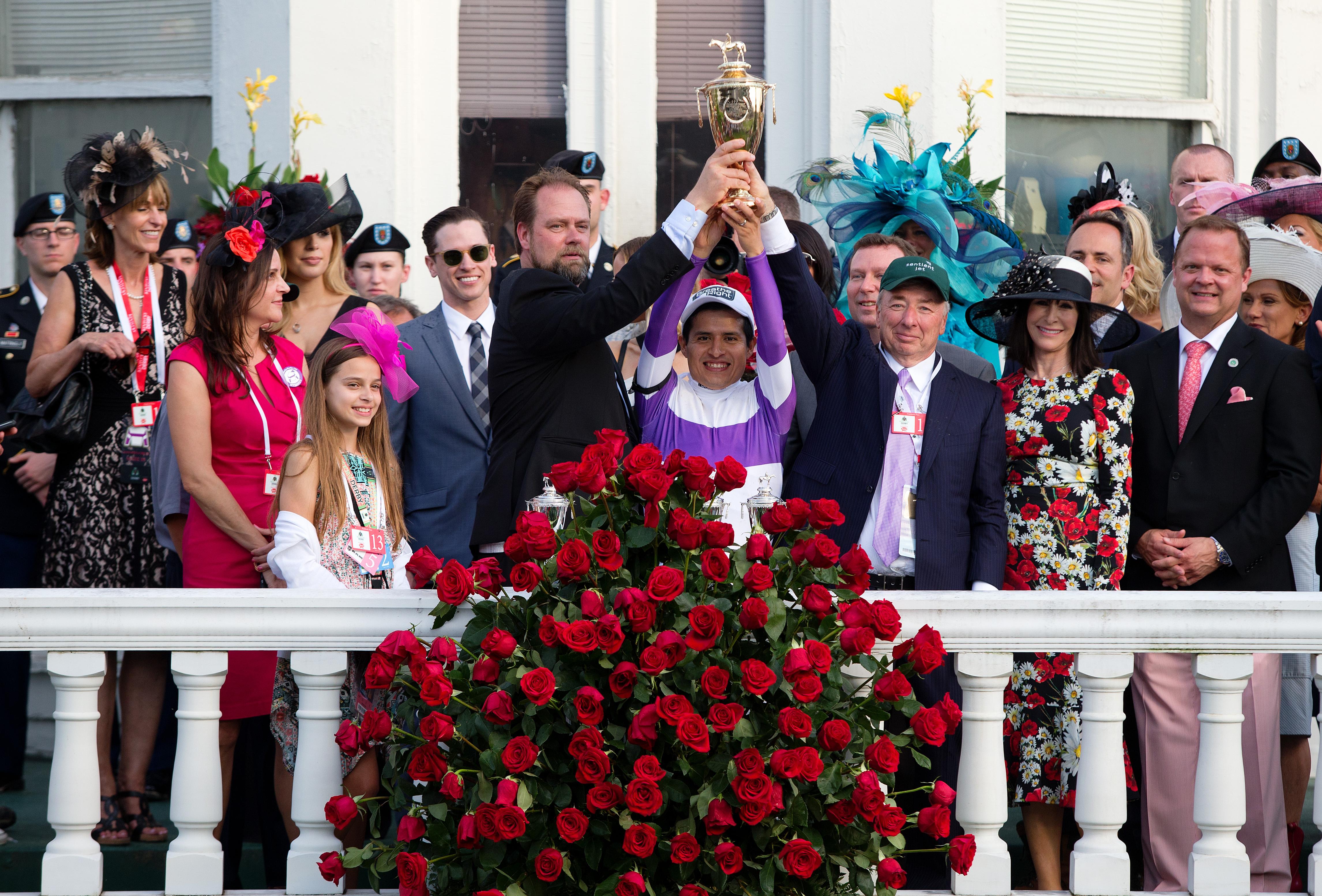 Trainer Doug O'Neill, jockey Mario Gutierrez and owner Paul Reddam celebrate their victory,