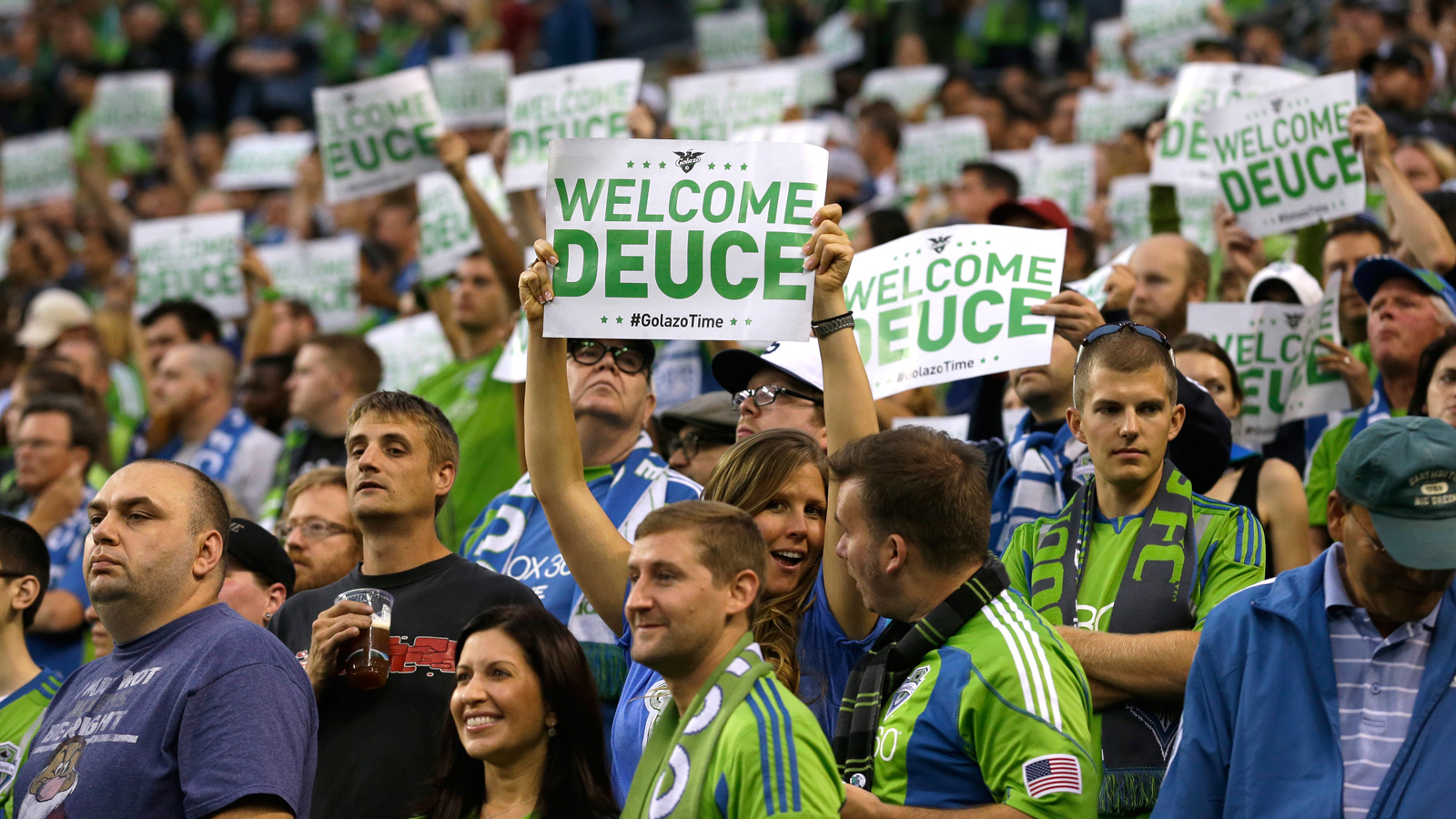 Seattle Sounders fans hold up signs welcoming Clint Dempsey ahead of his debut with the club after his landmark return to MLS.