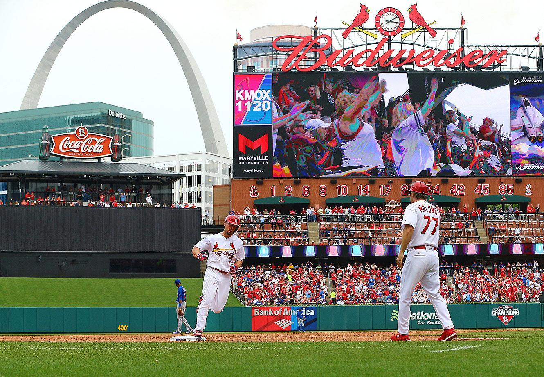 St. Louis Cardinals left fielder Matt Holliday (7) as seen rounding third base after hitting a home run in the bottom of the 6th inning at Bush Stadium.