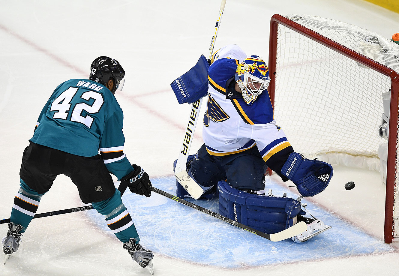 Joel Ward #42 of the San Jose Sharks scores his second goal on Brian Elliott #1 of the St. Louis Blues in Game Six of the Western Conference Final during the 2016 NHL Stanley Cup Playoffs at SAP Center on May 25, 2016 in San Jose, California.