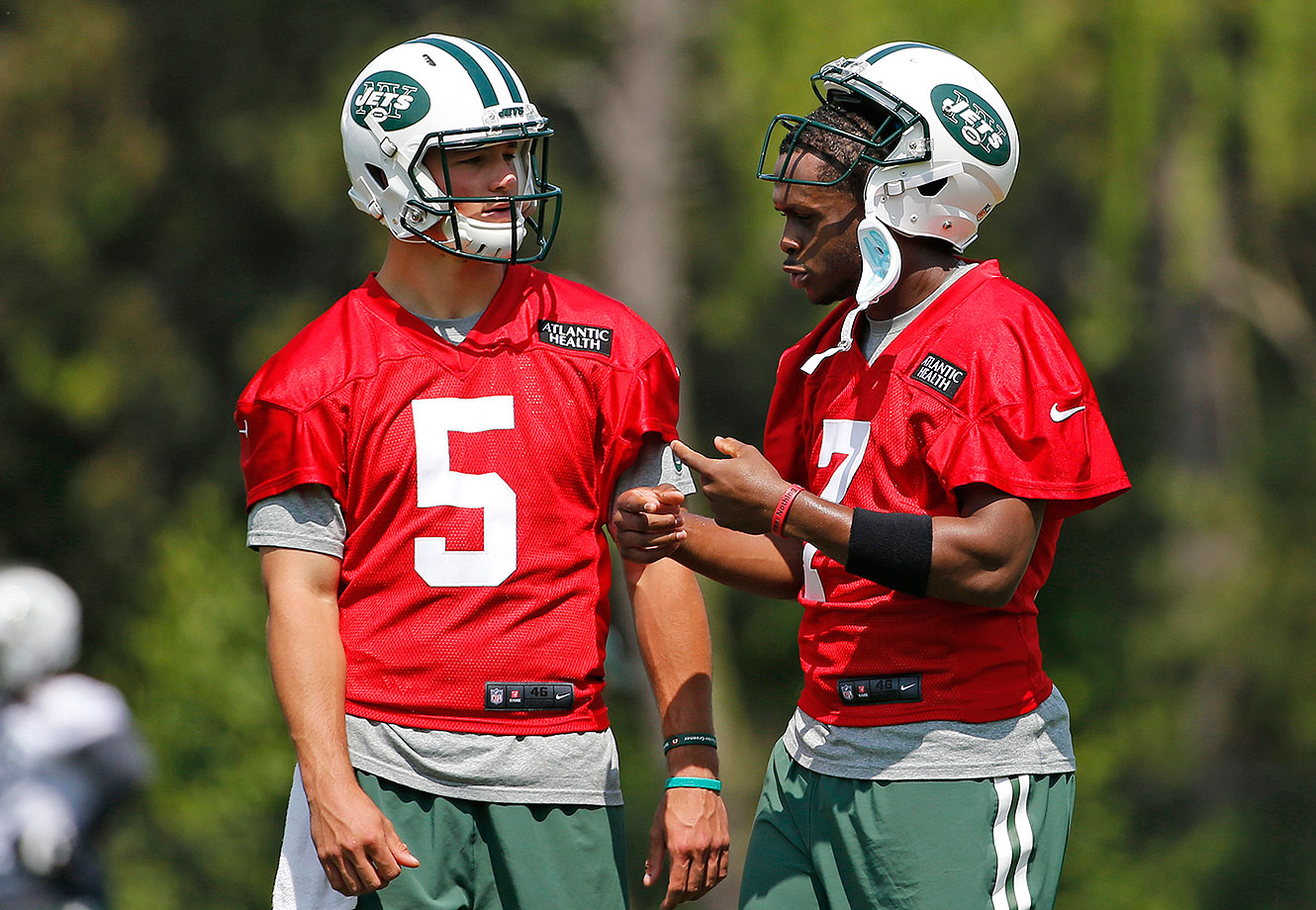 New York Jets rookie quarterback Christian Hackenberg, left listens as quarterback Geno Smith (7) speaks to him during NFL football practice, Wednesday, May 25, 2016, in Florham Park, N.J.