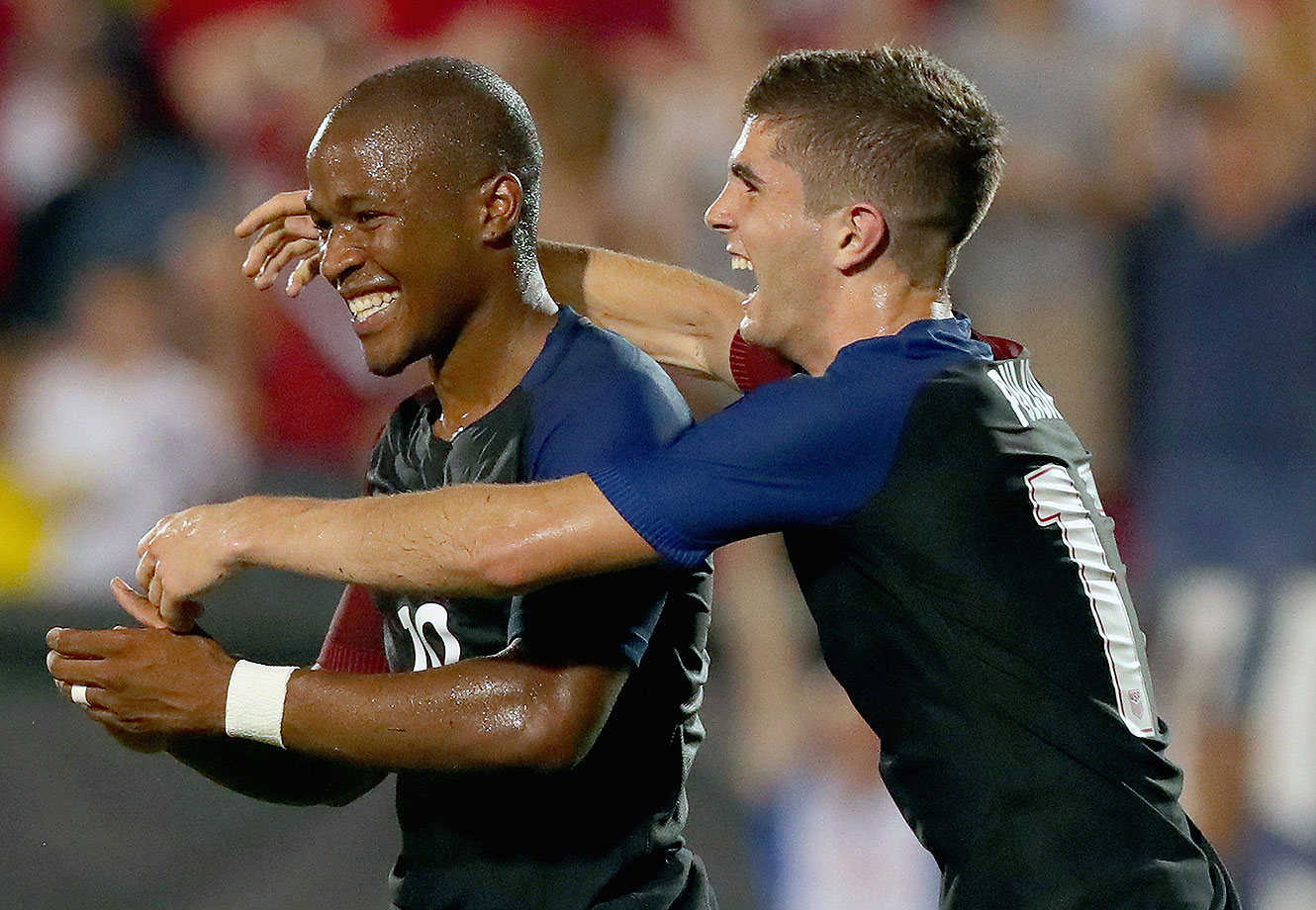 Nagbe Darlington #10 of the United States celebrates with Christian Pulisic #17 of the United States after scoring against Ecuador during an International Friendly match at Toyota Stadium on May 25, 2016 in Frisco, Texas.