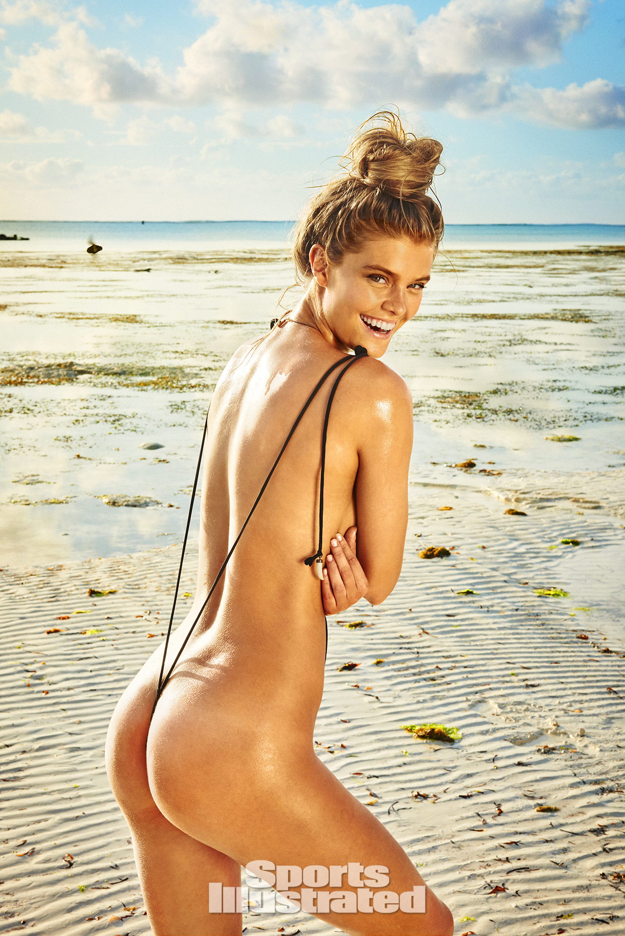 Nina Agdal was photographed by Ruven Afanador in Zanzibar. Swimsuit by GABRIELA PIRES BEACHWEAR.