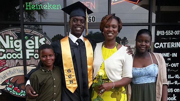 Chris celebrates high school graduation with his family. From left to right: Caleb, Chris, Sharonda and Camryn.