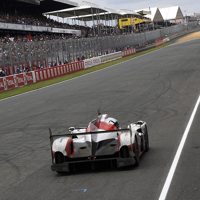 The Toyota TSO50 Hybrid N°5, driven by Japan's Kazuki Nakajima, is pictured at a standstill after it suffered engine failure, in the final lap of the 84th Le Mans 24-hours endurance race.