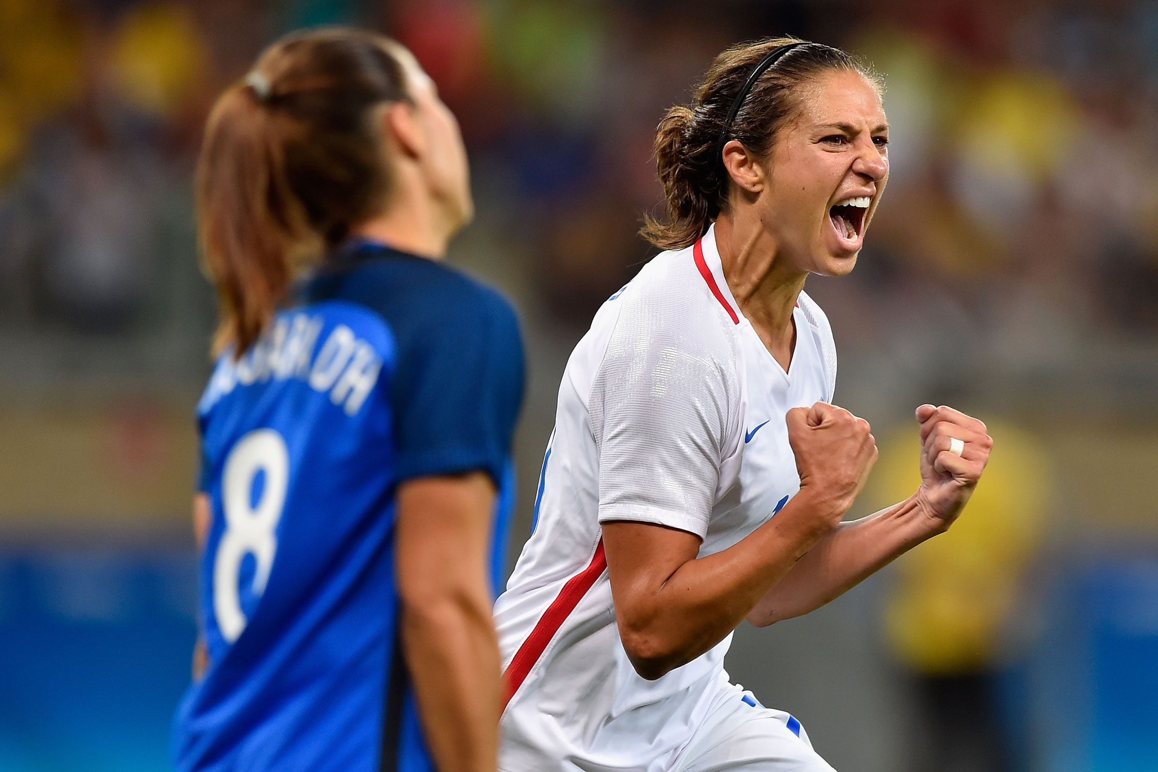 Carli Lloyd scores the only goal in a 1-0 win over a stout France side to punch the USA's ticket to the knockout stage at the Olympics.