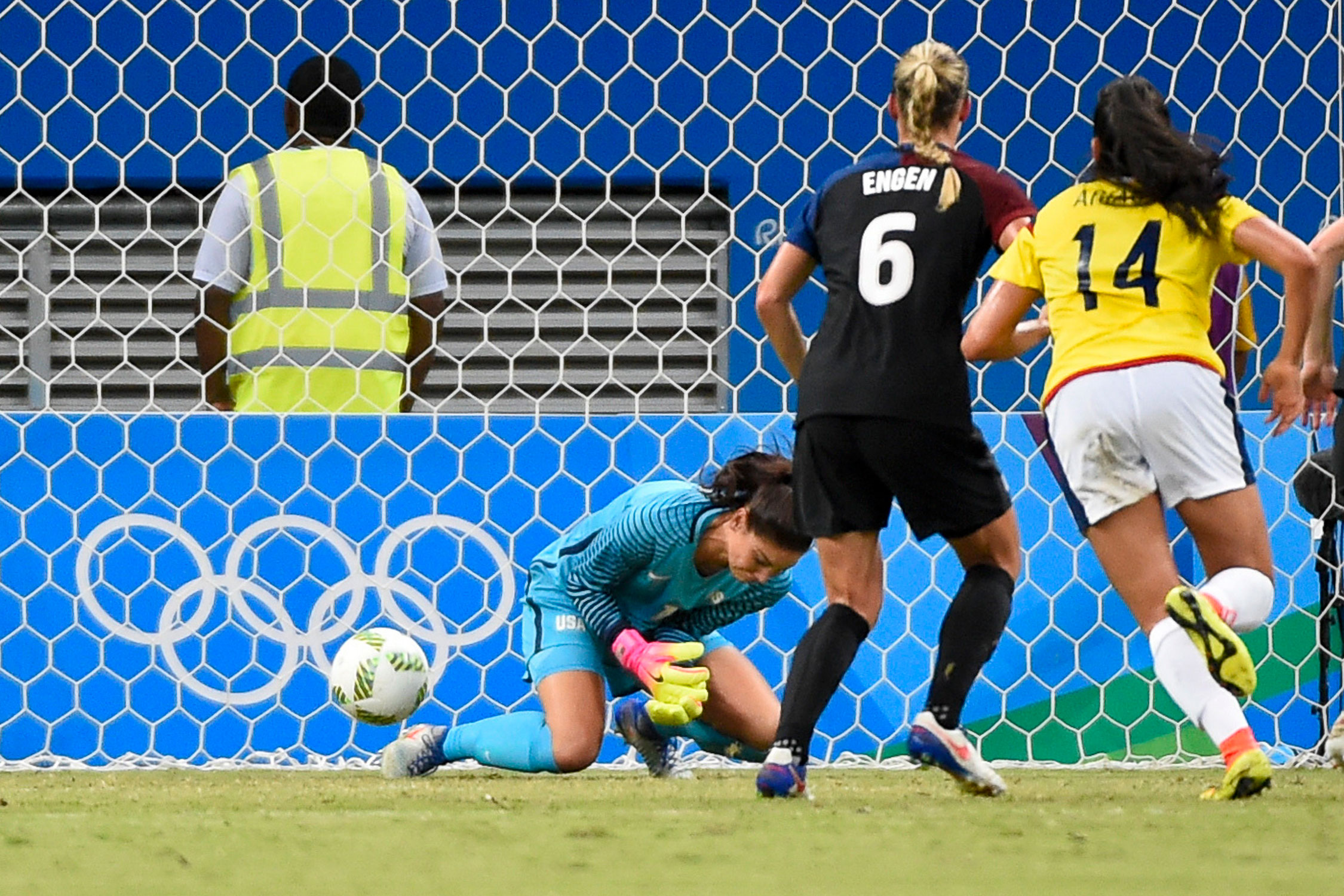 Hope Solo lets a Catalina Usme free kick slip through her hands and legs in a shocking 2-2 draw. The USA still won its Olympic group despite the slip-up.
