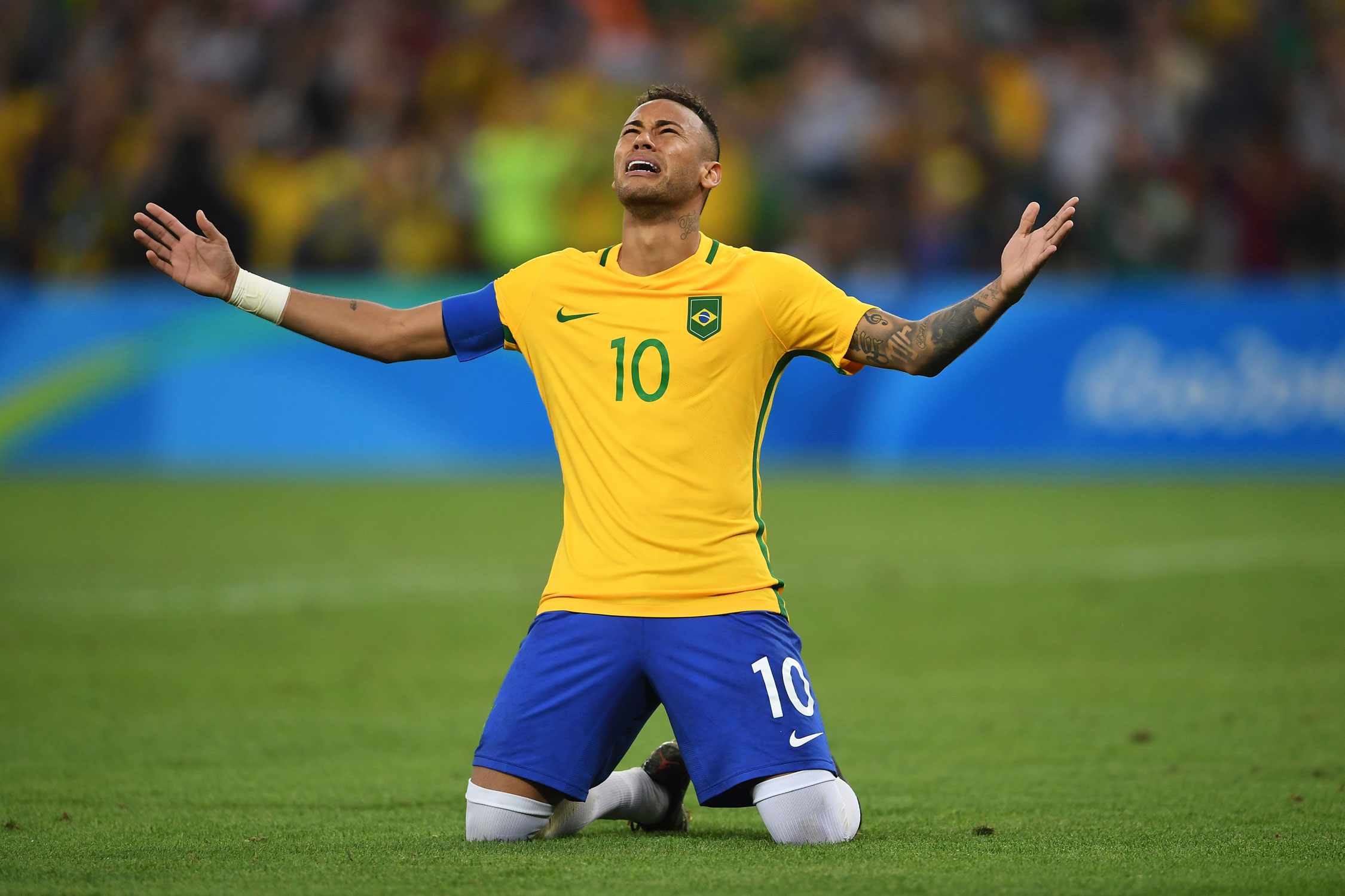 Neymar collapses to the ground overcome with emotion after his decisive penalty kick clinched Brazil's first Olympic gold medal in soccer.