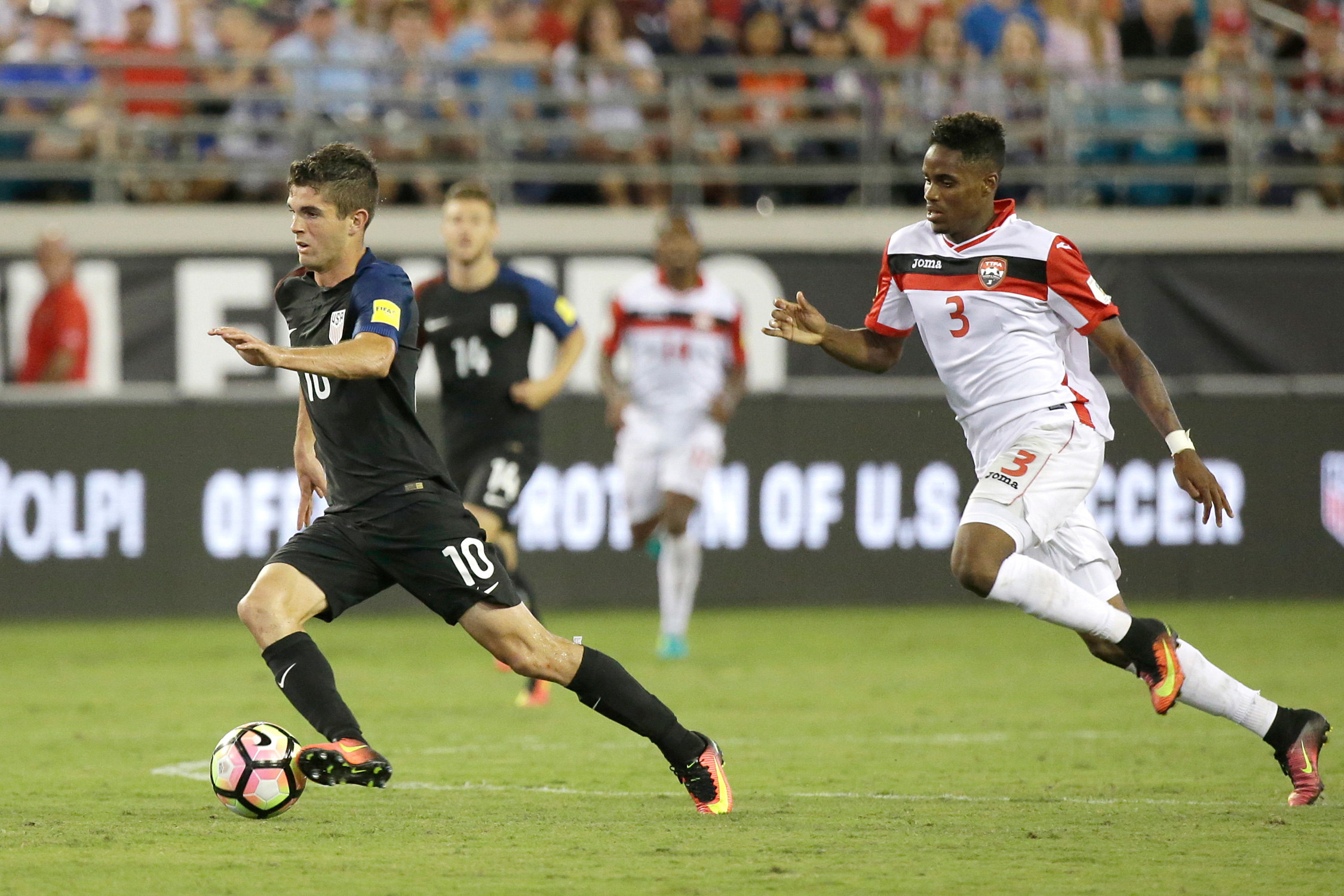 Christian Pulisic blows by Joevin Jones in the USA's 4-0 World Cup qualifying win over Trinidad and Tobago on Sept. 6, 2016, in which he assisted on a goal scored by Jozy Altidore.